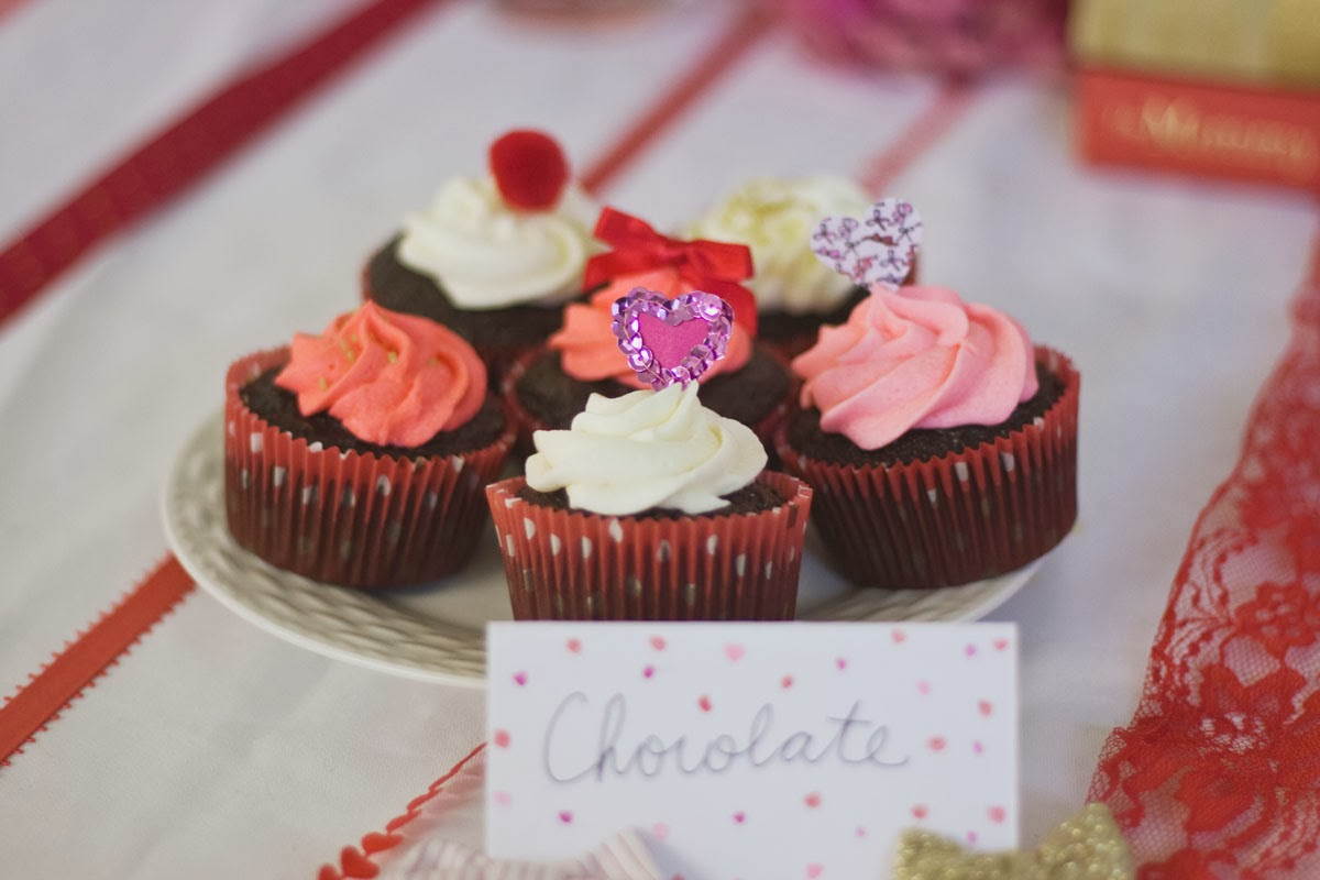 Coral, red, and pink cupcakes
