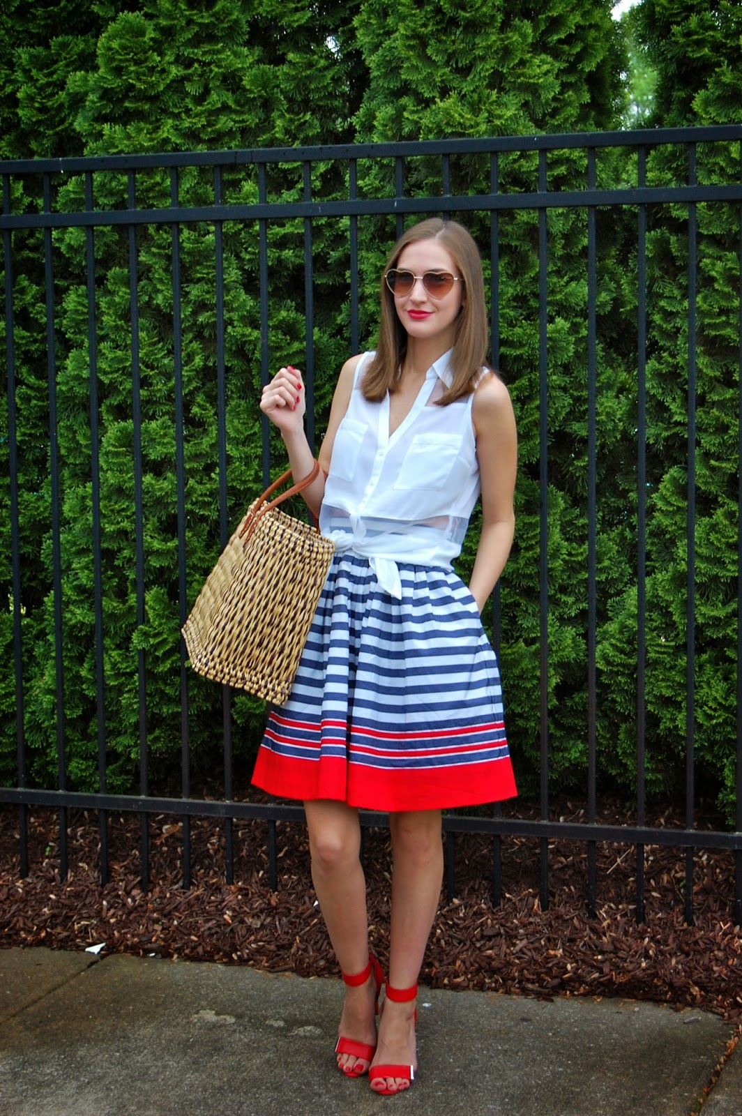 Wearing a Red, white and blue skirt. Memorial Day Weekend outfit. eShakti Skirt, Wearing heart shaped sunglasses, Summer look