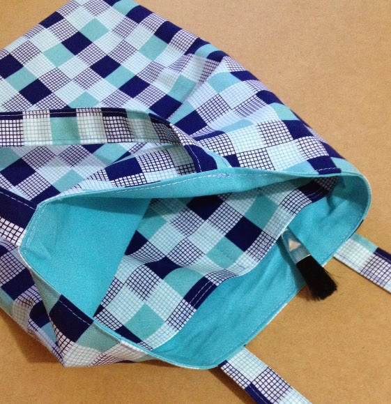 Lined bag with internal pocket