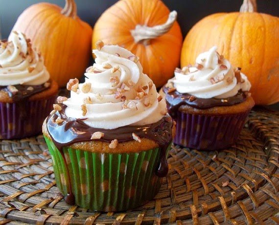 http://www.cookingclassy.com/2011/10/pumpkin-cupcakes-with-chocolate-ganache-and-spiced-cream-cheese-frosting/