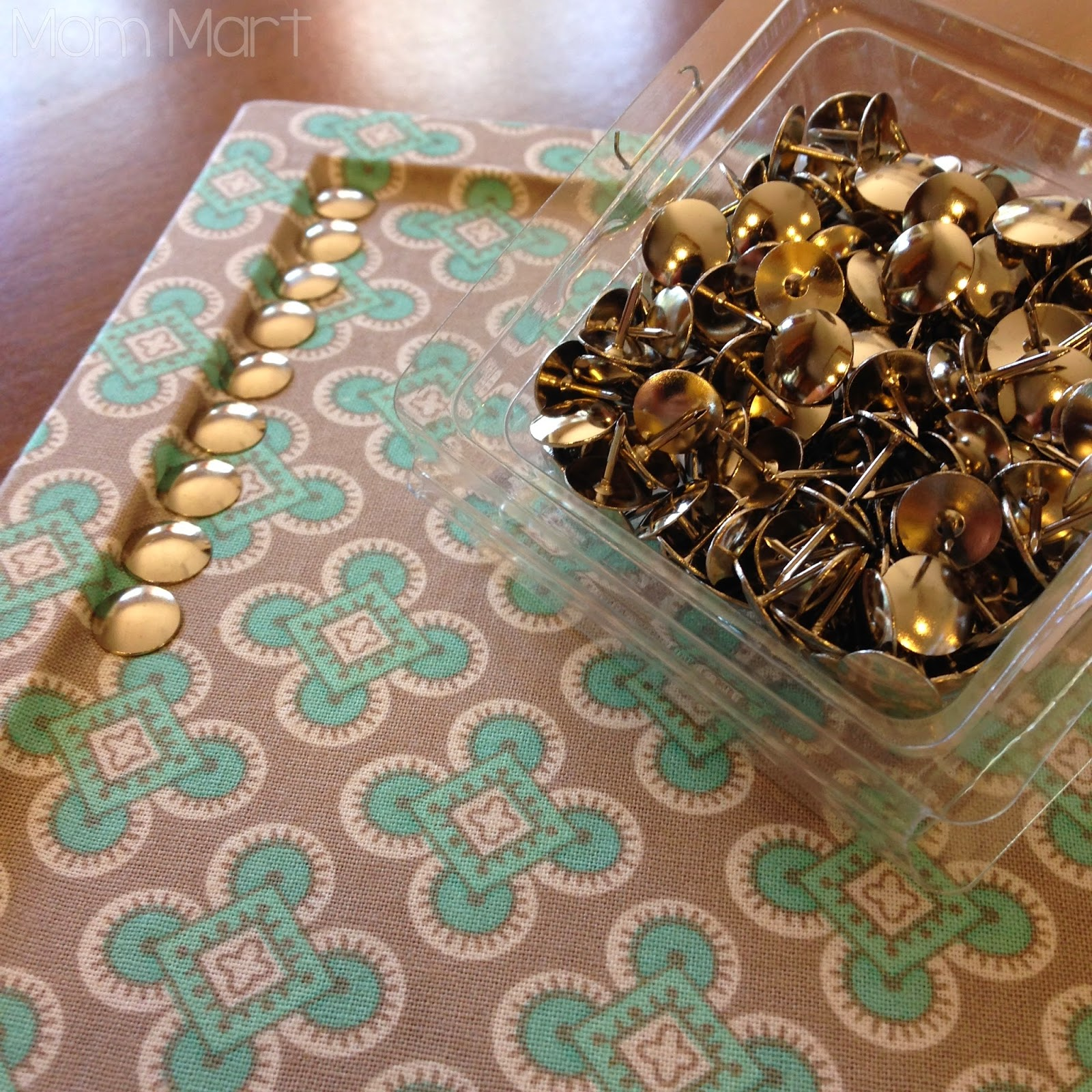 DIY fabric covered cork board with a faux nail head trim #DIY #HomeDecor #FauxNailHeadTrim