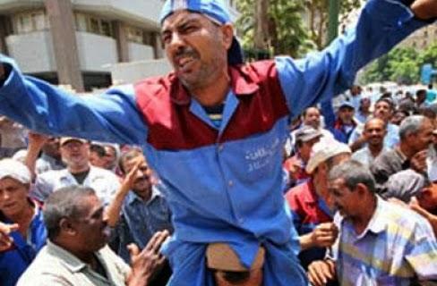 اعتصام عمال نظافة الجيزة للمطالبة