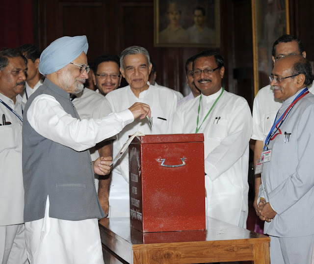 Prime Minister Dr. Manmohan Singh casts his vote in Presidential Election at Parliament House, New Delhi, in the presence of Sh. Satya Pal Jain, Polling Agent of Sh. P. A. Sangma.