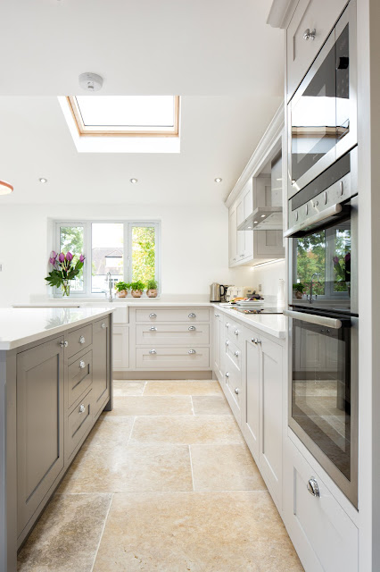 white and grey shaker kitchen with island and white walls