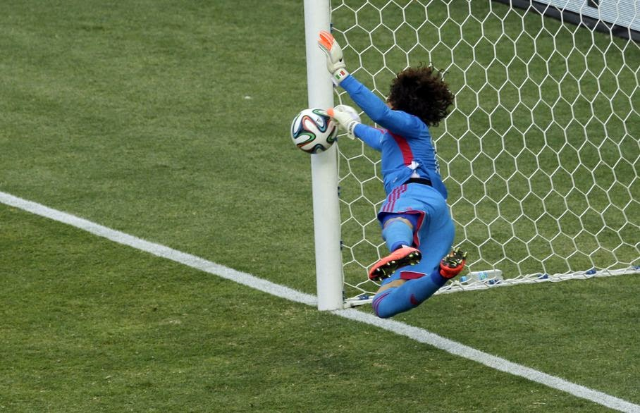 Mexico's goalkeeper Guillermo Ochoa makes a save during the group A World Cup soccer match between Brazil and Mexico at the Arena Castelao in Fortaleza, Brazil, Tuesday, June 17, 2014.