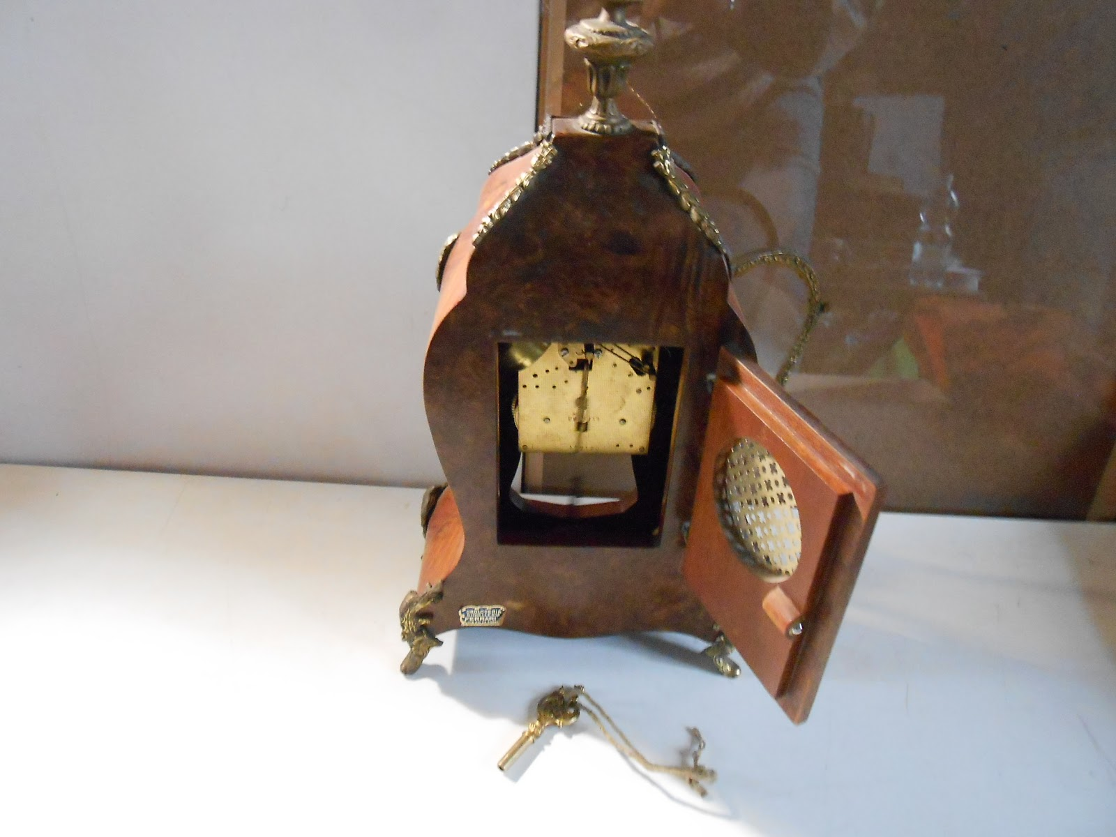 Orologio a pendolo da tavolo ligneo con inserti in bronzo continua a legger ebay - Orologio a pendolo da tavolo ...