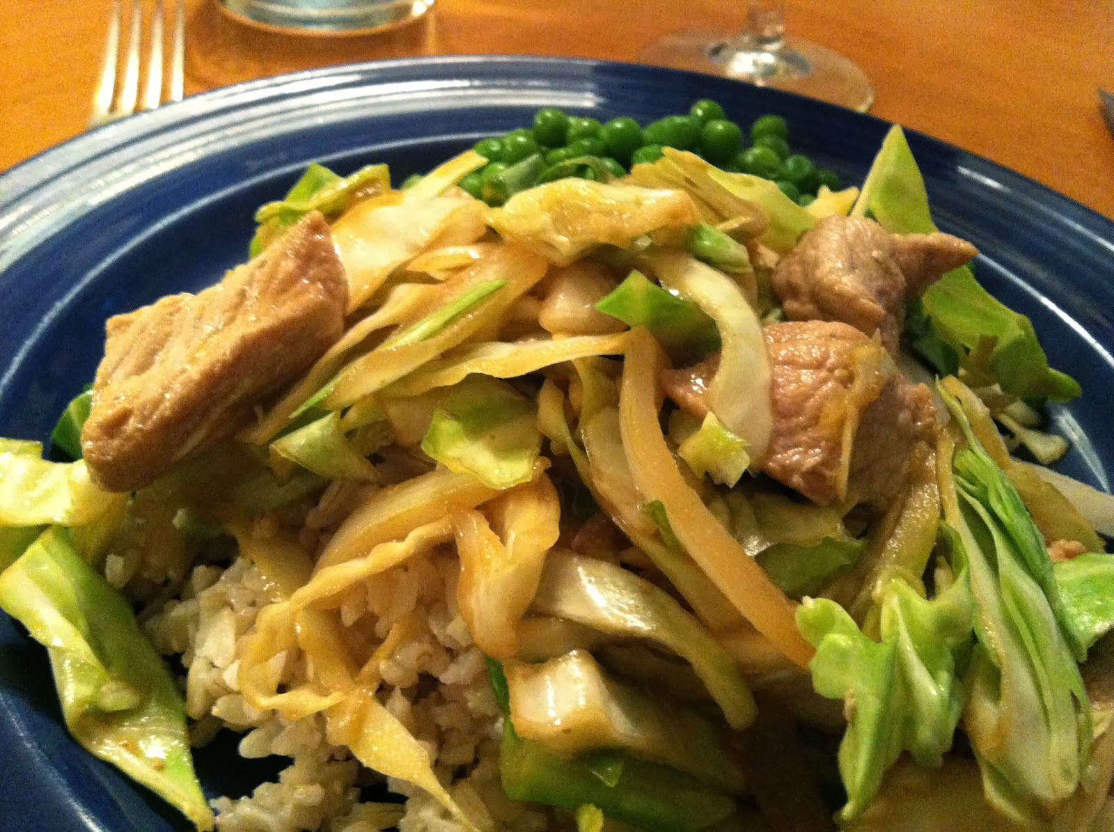 pork and cabbage served over brown rice