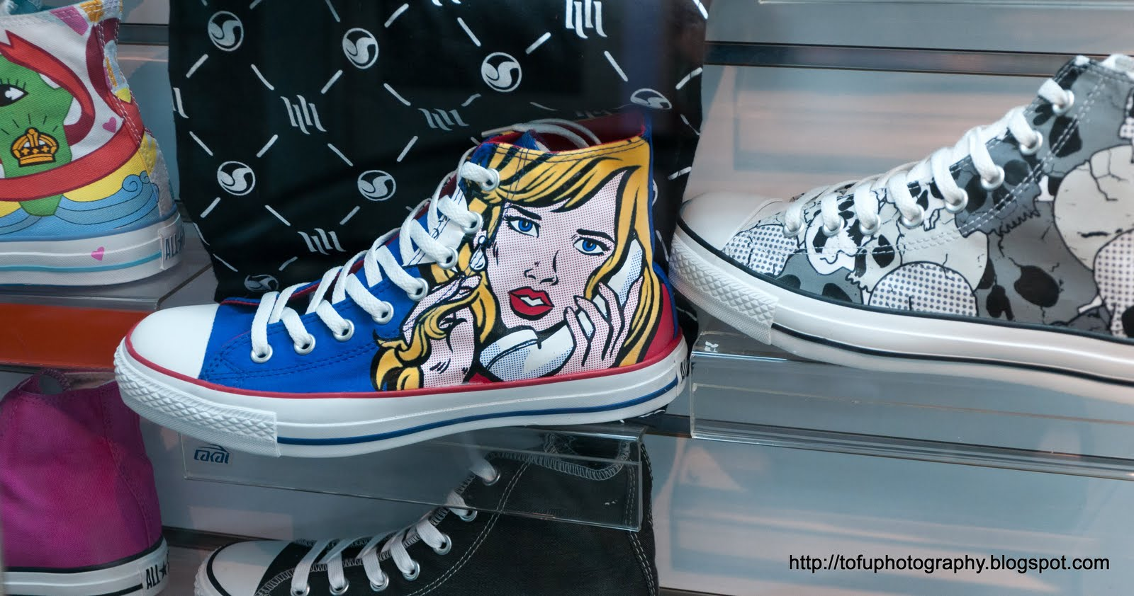 Great canvas shoes for sale in a shop in Taipei, Taiwan in August 2010.  Woman on the phone