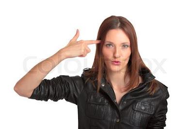 النساء اقل اقدام على الانتحار من الرجال - pretty-young-woman-showing-suicide-gesture-isolated-on-white