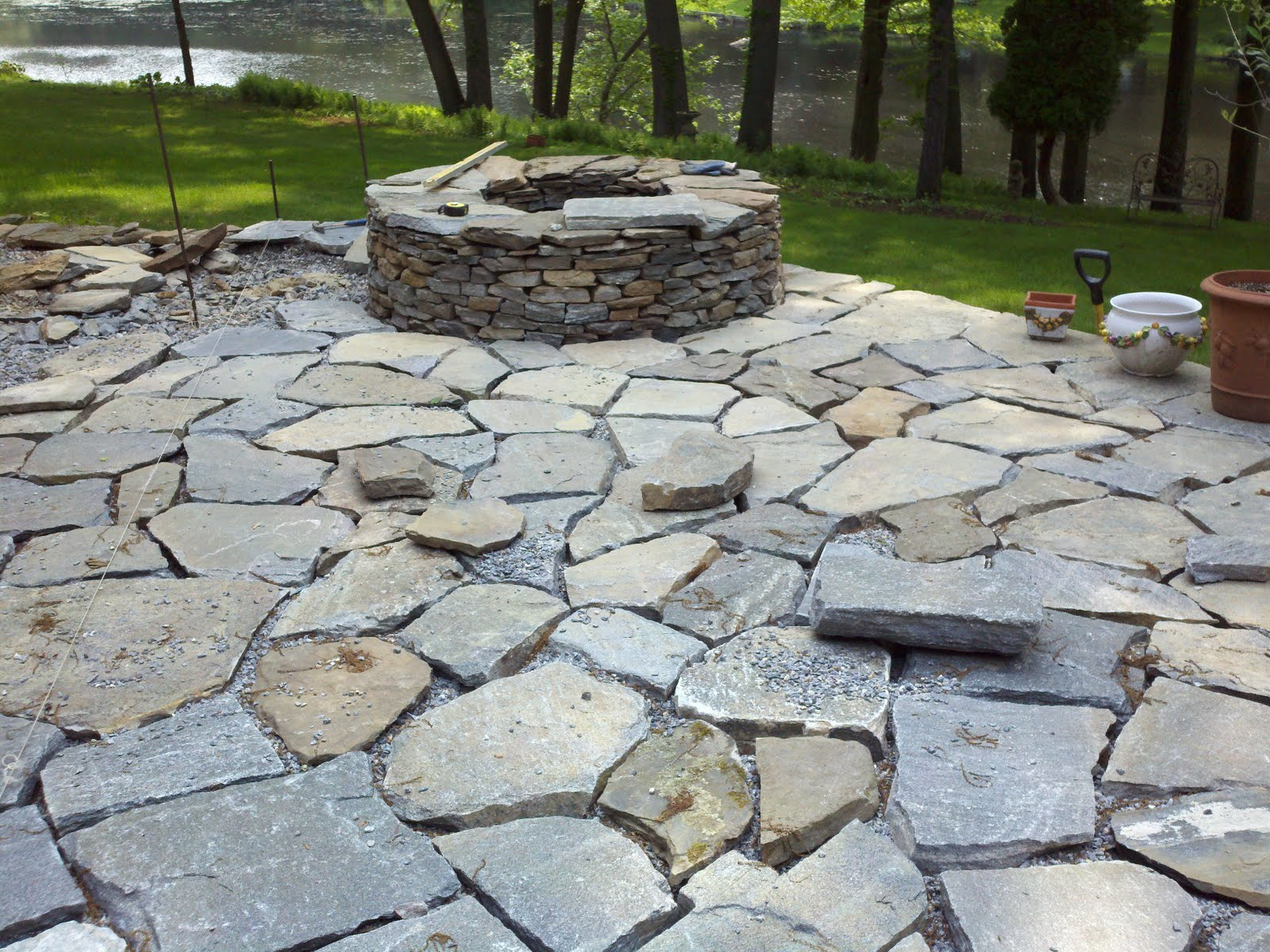 Heave and hoe stone patio and rediscovered well for Pictures of stone patios