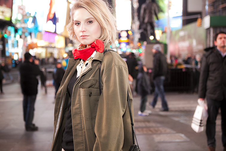 Fashion Over Reason's Hélène Heath in Times Square at nighttime, New York City, blonde, blond bob, army jacket