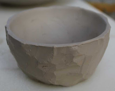 wet carved pottery bowl