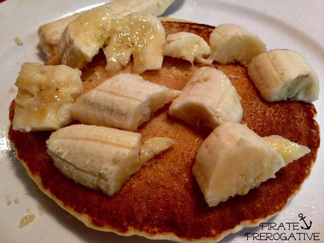Ultimate Vegan Pancakes topped with fresh bananas