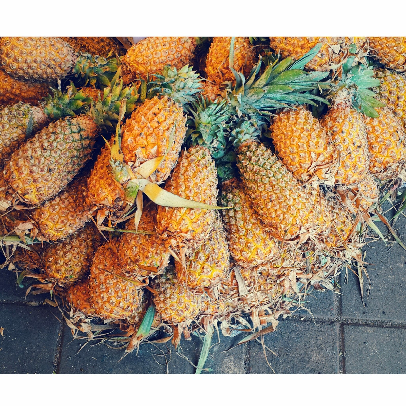 The perfect fruit for the summer, a mound of pineapples are organised to be sold at the market