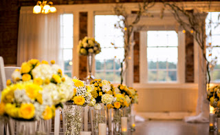 Yellow flowers and wedding rings - Kent Buttars, Seattle Wedding Officiant
