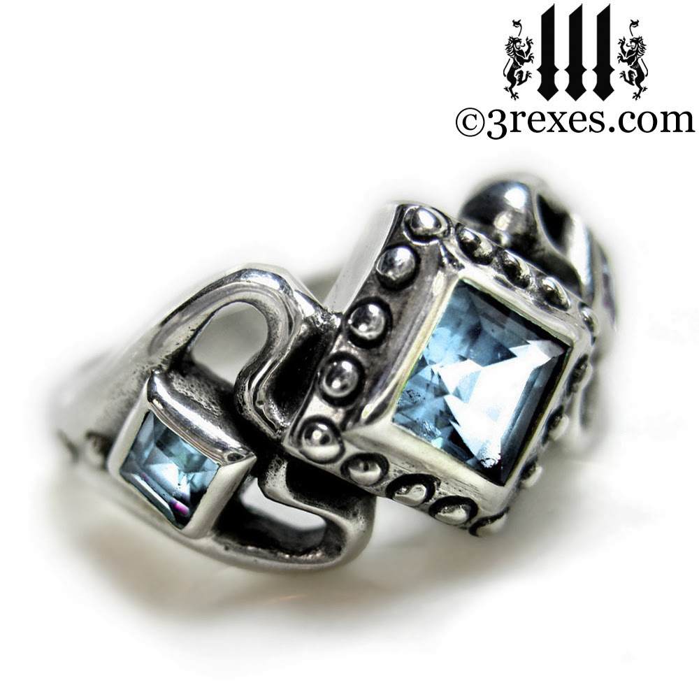 princess love gothic engagement ring with blue topaz stones