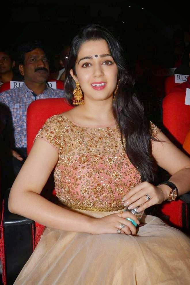 Charmi Kaur White Gown Photos