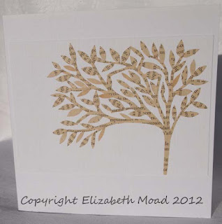 Hand paper cut tree design by Elizabeth Moad