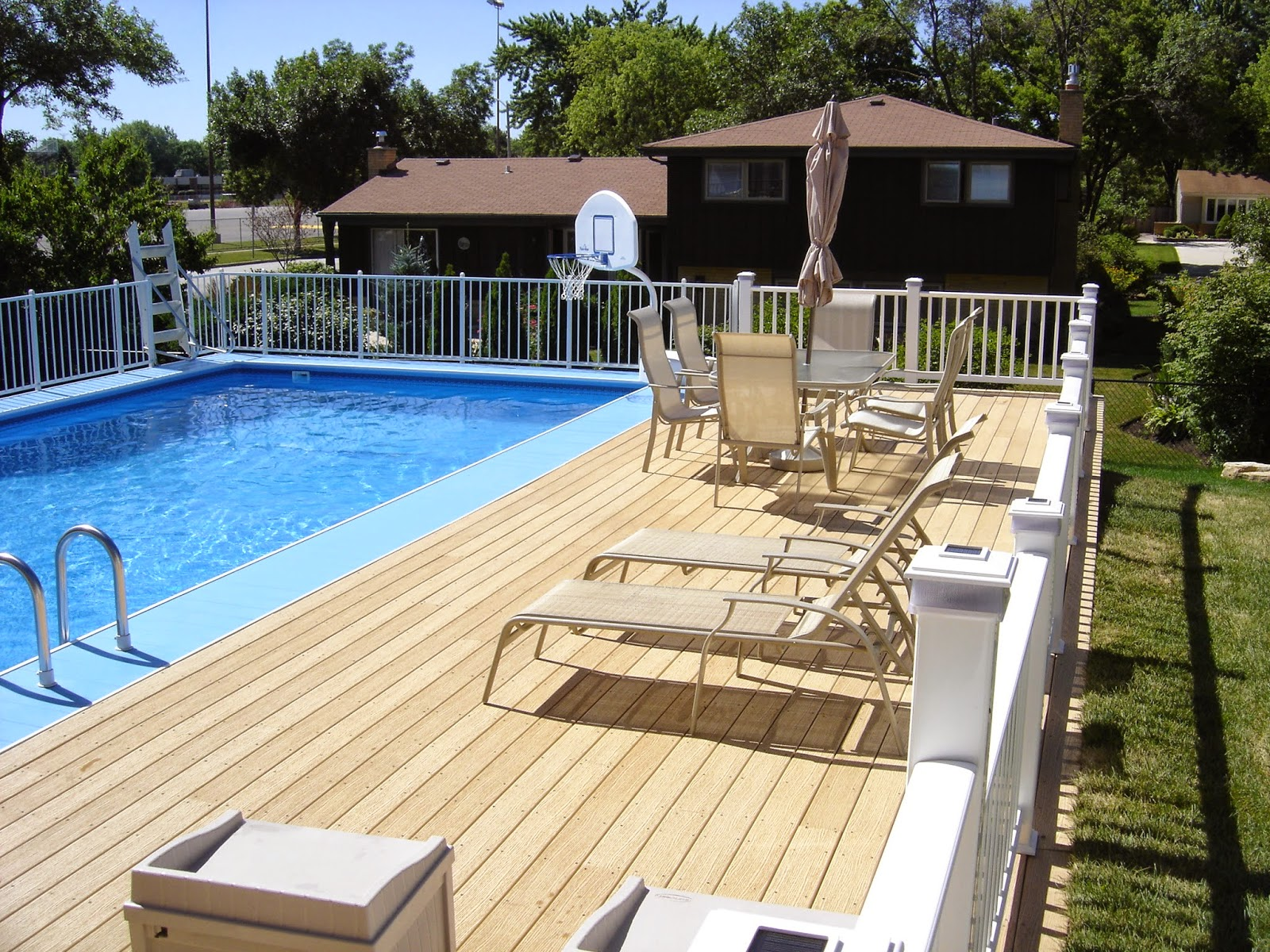 Above ground pool deck kits roselawnlutheran for Deck from house to above ground pool