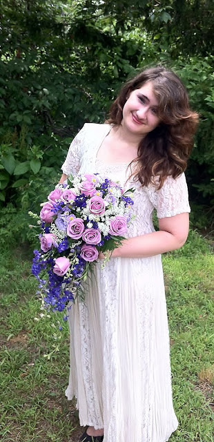 A bridal cascade of purple and lavender blooms by Stein Your Florist Co.