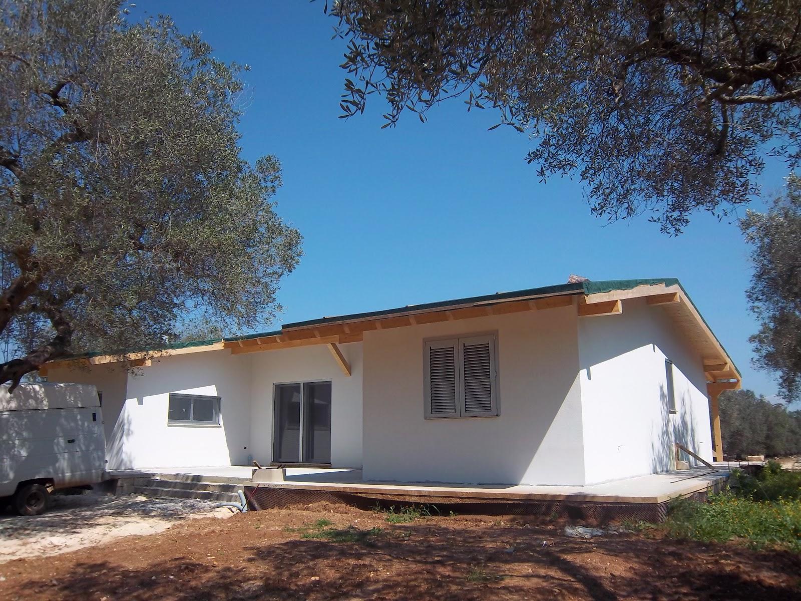 Progetti di case in legno casa 129 mq porticati 57 mq for Progetti di case costiere