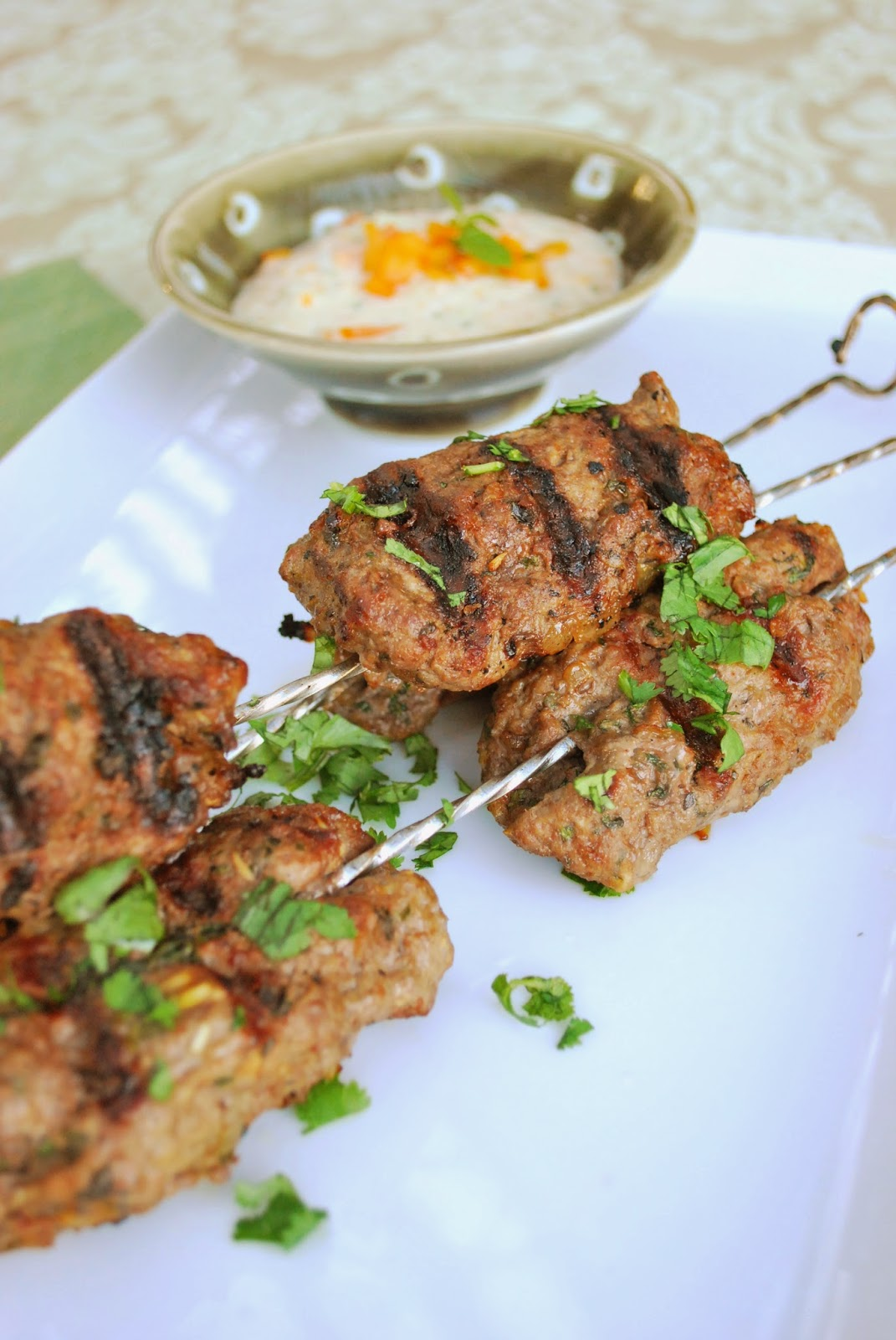 Lamb Kebabs with Sweet Pepper Cucumber Raita: These simple, yet flavorful lamb kebobs paired with raita are great for serving at a party or make for a fun dinner at home.