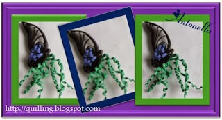 Check out this fun Quilling, Paper Filigree project. This cute witches hat with green hair from Antonella at www.quilling.blogspot.com