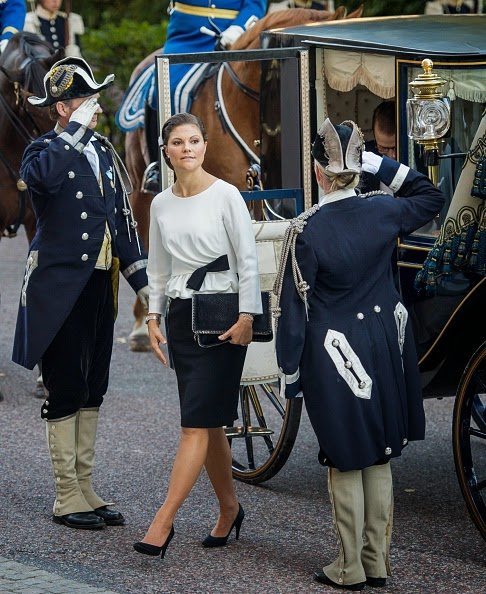 Sweden's Crown Princess Victoria and Prince Daniel (R) arrive to attend the opening of the Swedish parliament in Stockholm