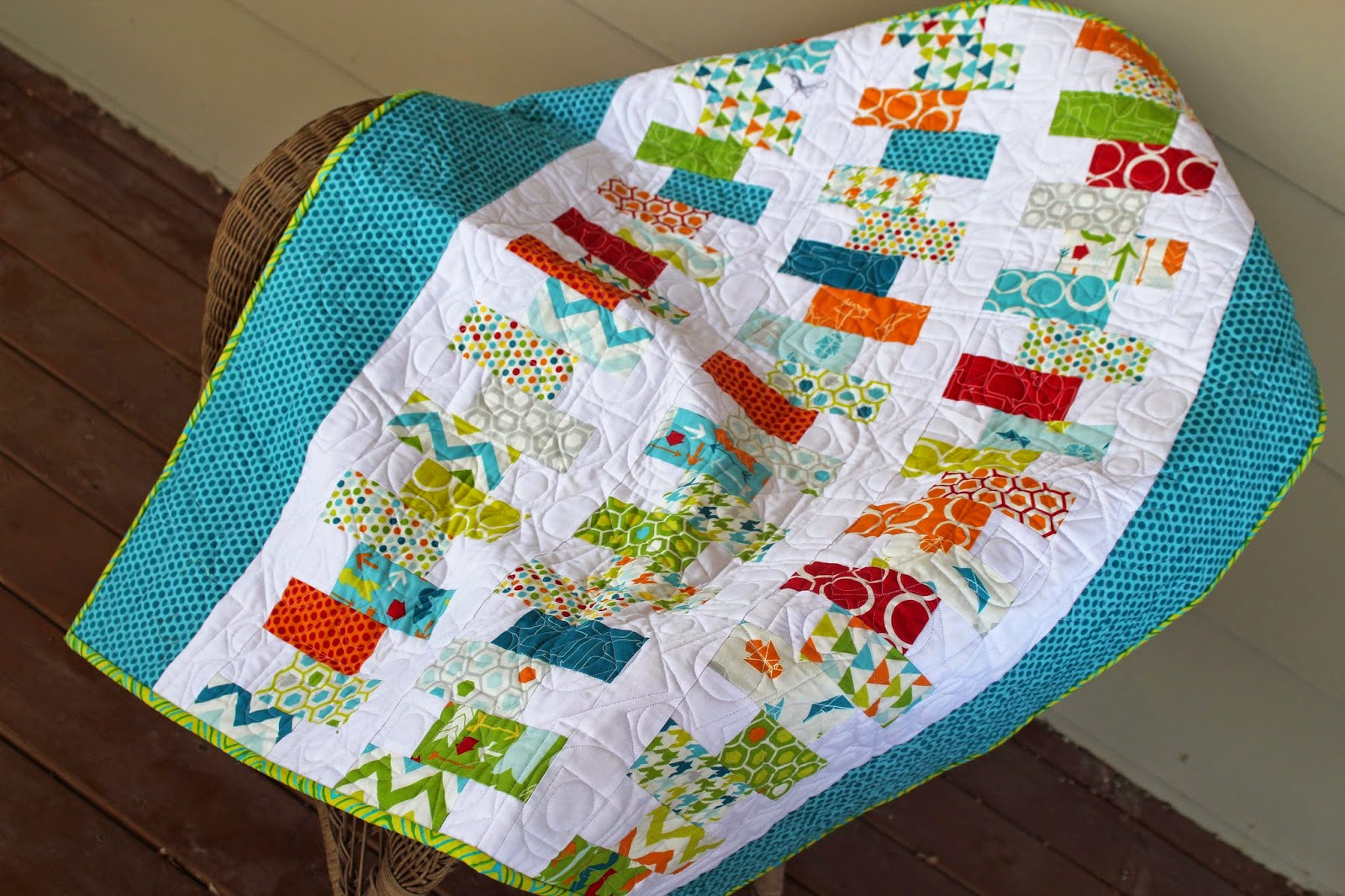 Charm pack cut in half to make a staggered row quilt.