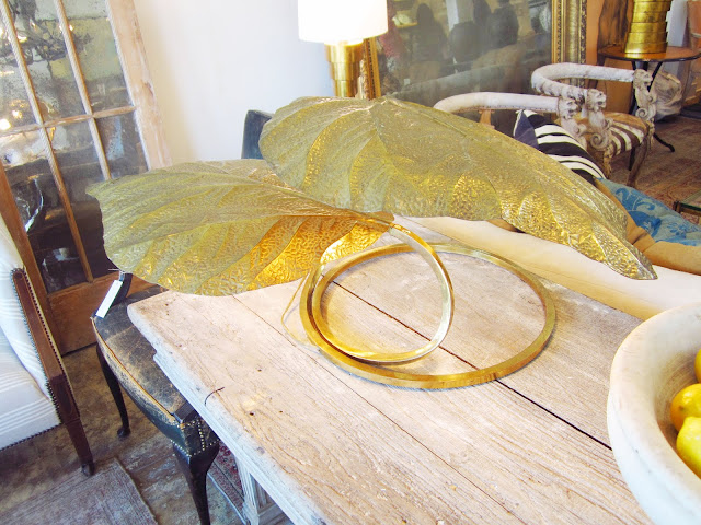 vintage brass table lamp in the form of large leaves on a wood table