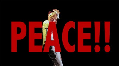 PEACE!! in large red letters over Maya dancing.