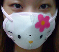 Cute asian girl wearing weird Hello Kitty face mask