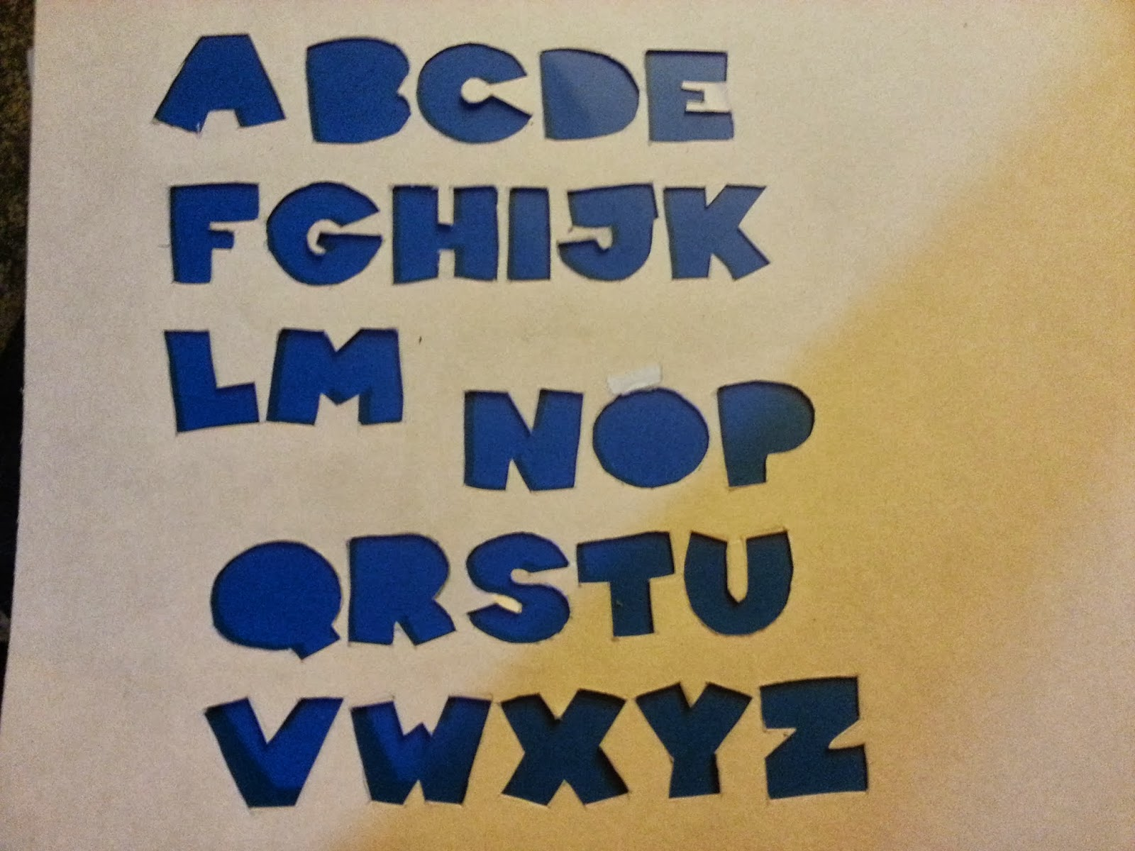 when you are all finished you can flip over the construction paper and there you will have a nice letter stencil
