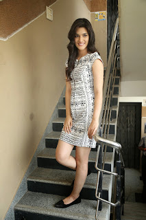 Kriti Sanon Young and Beautiful in a White Mini Dress at Dochay movie promo interview