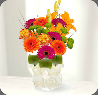 orange pink flower bouquet hand tied