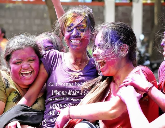 Girls enjoying on Holi with Colours and waters
