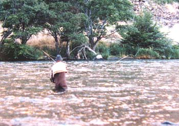 Picture of a man fly fishing on a large river in Oregon's high desert.