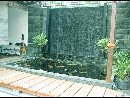kolam ikan rumah minimalis batu alam
