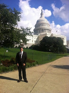 Congressional Intern Justin Davidson stands in front of The Capitol in Washington.
