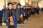 Recent Ph.D. graduates line up for Commencement.