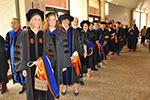 Recent Ph.D. graduates line up for Commencement.