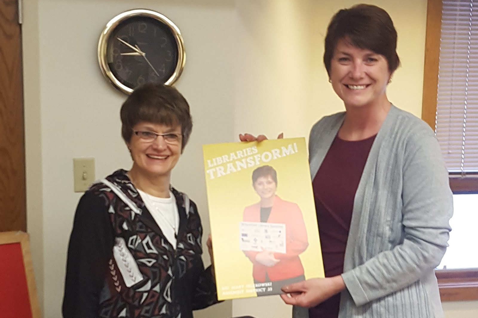"""Library Director Mary Dunn presented """"Wisconsin Library Association Champion"""",  Rep. Felzkowski wi"""