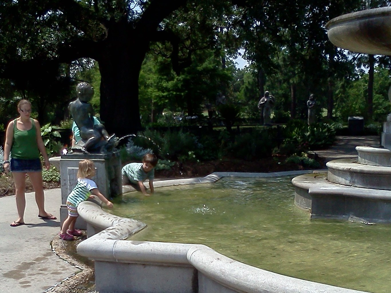 Children playing at the fountain