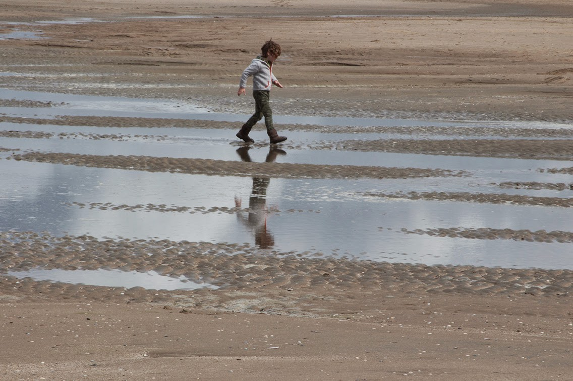 boy walking through water