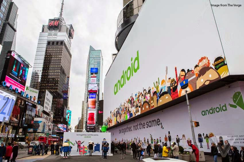 street perspective of white billboard with android written in green.
