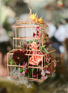 Our birdcage with flowers used in a wedding