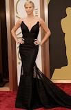 Чарлийз Терон в черна рокля с прозрачно на Оскари 2014