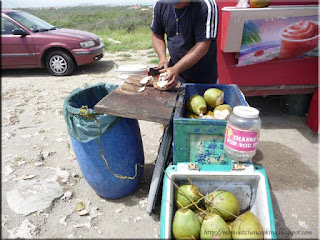 the coconut man preparing coconuts