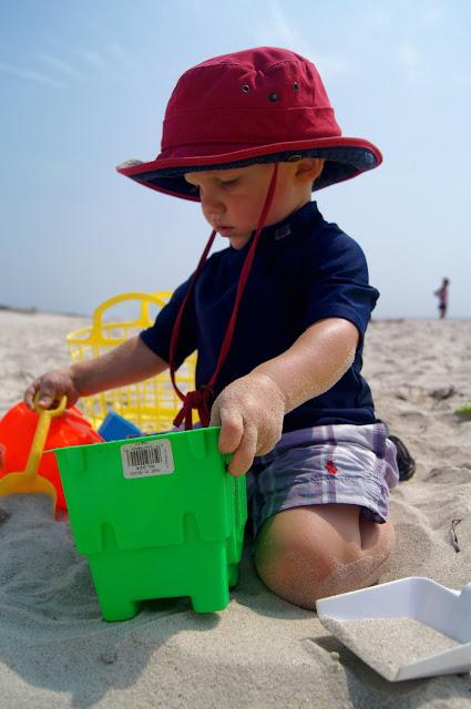 baby building sand castle