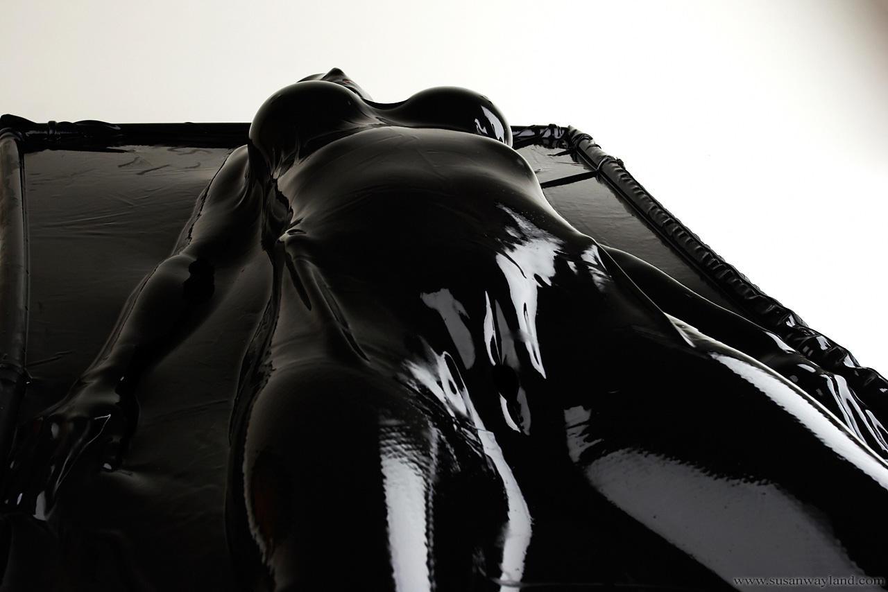 woman Latex vacuum bed